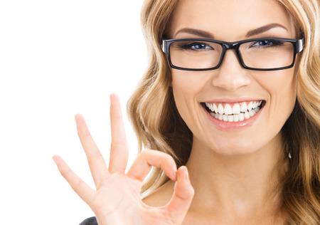 Foto de Happy smiling business woman with okay gesture, isolated over white background - Imagen libre de derechos
