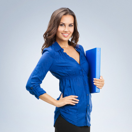 Portrait of young happy smiling business woman with blue folder