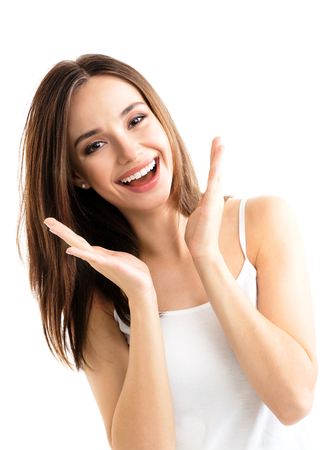 Foto de Young woman showing smile, in casual smart clothing, isolated against white background. Caucasian brunette model in emoshions and optimistic, positive, happy feeling concept studio shoot. - Imagen libre de derechos