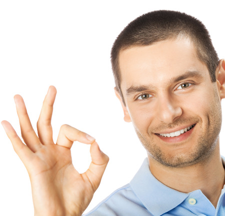 Photo for Portrait of cheerful young man showing okay gesture, isolated over white background - Royalty Free Image