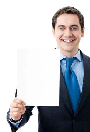 Photo pour Young happy smiling businessman showing signboard with copyspase for text or slogan, isolated over white background - image libre de droit