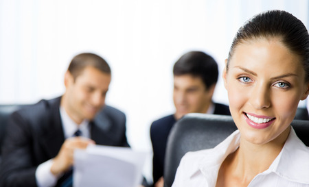 Photo for Portrait of happy smiling businesswoman and colleagues on background, at office - Royalty Free Image