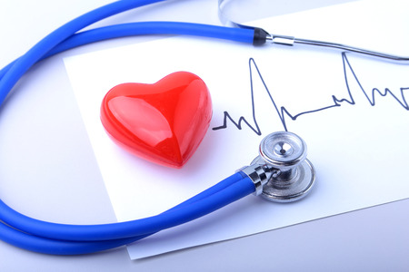 Foto de Medical stethoscope and red heart with cardiogram isolated on white. medical healthcare concept - Imagen libre de derechos