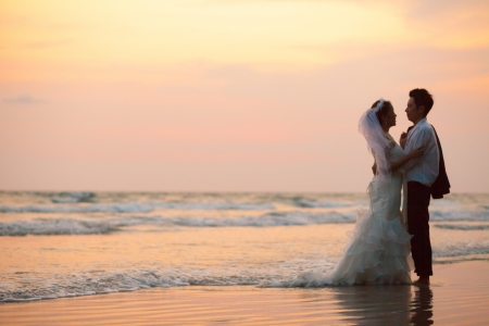happiness and romantic Scene of love couples partners wedding on the Beach