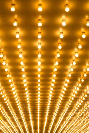 Photo pour golden bulbs marquee lights background - image libre de droit