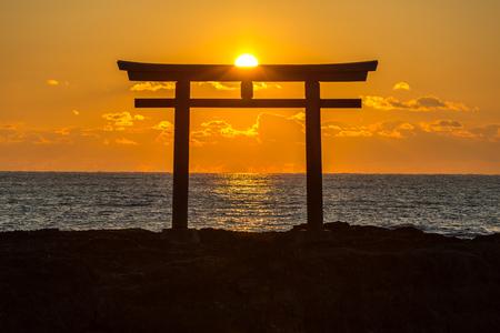 Foto de Torii Japanese shrine gate sunrise at sea Oarai city , Ibaraki Japan - Imagen libre de derechos