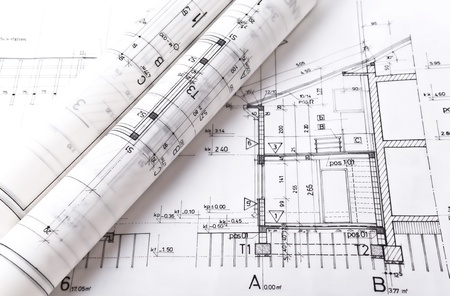 Photo pour Architect rolls and plans project blueprint - image libre de droit