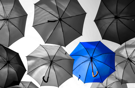 Foto per umbrella standing out from the crowd unique concept - Immagine Royalty Free