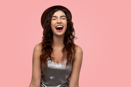 Photo for Excited  adult girl closing her eyes and opening mouth screaming with happiness rejoicing her success in life. Shining woman enjoying her life. Happiness and joy concept. - Royalty Free Image