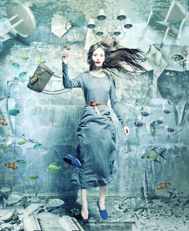 Photo for a pretty woman underwater in the flooded interior. creative concept - Royalty Free Image