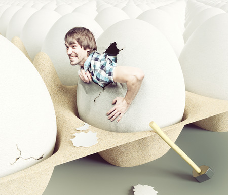 Foto de Man hit shell, getting out of eggs. Creative concept - Imagen libre de derechos