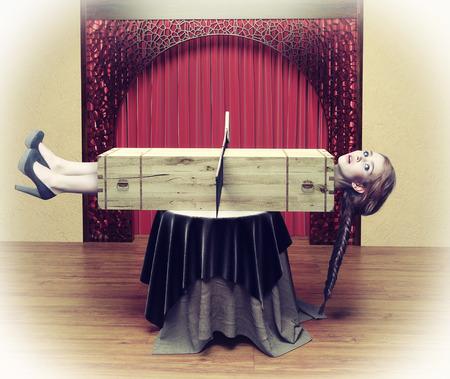 Foto de Magician sawing a woman with a saw.Photo combination concept - Imagen libre de derechos