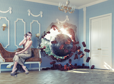 Photo pour wrecking ball enters the room, scaring the woman on the sofa. Photo combination creative concept - image libre de droit