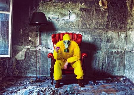 Foto de protective overall man closed in the burnt interior. Photo combination concept - Imagen libre de derechos