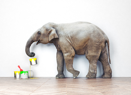 Foto de An elephant with paint cans. Photo combination concept - Imagen libre de derechos