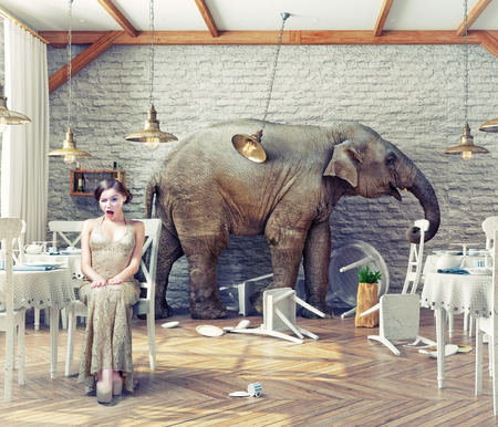 Photo pour the elephant calm in a restaurant interior. photo combination concept - image libre de droit