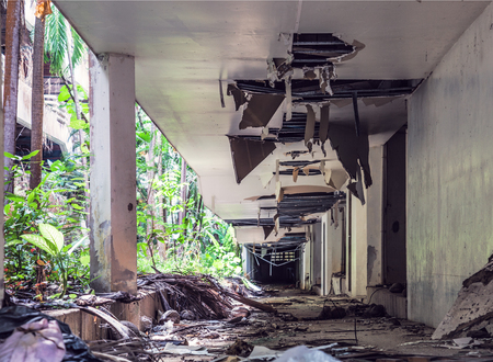 Foto de Destroyed Jungle overgrown buildings after 2004 tsunami.  Thailand. Phuket - Imagen libre de derechos