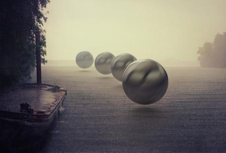 Photo pour mystery spheres over the rain lake. Photocombination concept - image libre de droit
