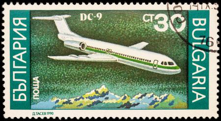 Foto de MOSCOW, RUSSIA - APRIL 18, 2016: A stamp printed in Bulgaria shows passenger aircraft Douglas DC-9, series Airplanes, circa 1990 - Imagen libre de derechos