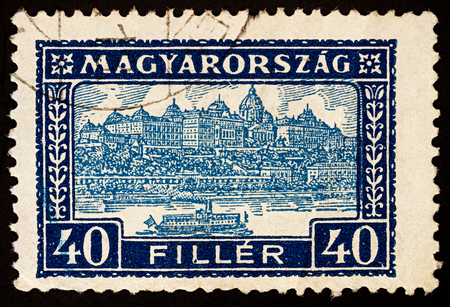 Foto de Moscow, Russia - November 26, 2017: A stamp printed in Hungary shows Buda Castle Royal Palace, residence of the Hungarian kings in Budapest, Hungary, series Palace of Buda, circa 1926 - Imagen libre de derechos
