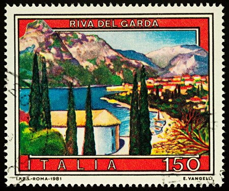 Foto de Moscow, Russia - December 03, 2017: A stamp printed in Italy shows town of Riva del Garda in northern Italy, series Tourist Attractions, circa 1981 - Imagen libre de derechos