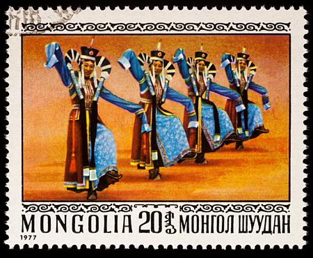 Foto de Moscow, Russia - January 08, 2018: A stamp printed in Mongolia, shows Mongolian women in 13th Century Costumes, series Folk Dances, circa 1977 - Imagen libre de derechos