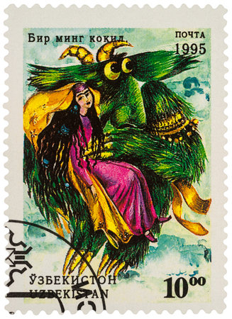Foto de Moscow, Russia - January 15, 2018: A stamp printed in Uzbekistan shows woman and monster bird, a scene from Asian fairy tale Thousand plaits, series Folk Tales, circa 1995 - Imagen libre de derechos