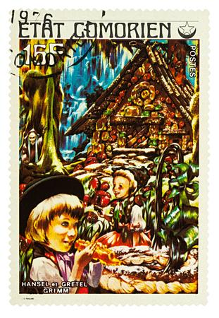 Foto de Moscow, Russia - January 17, 2018: A stamp printed in Comoros shows scene from a fairy tale Hansel and Gretel, series Children's Book, circa 1976 - Imagen libre de derechos