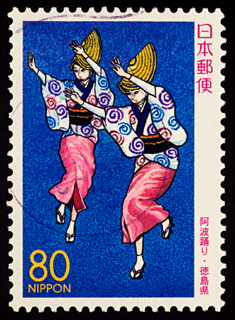 Foto de Moscow, Russia - January 31, 2018: A stamp printed in Japan shows two Japanese dancing women, Awa Odori Dancers, series Prefectural Stamps - Tokushima, circa 2000 - Imagen libre de derechos
