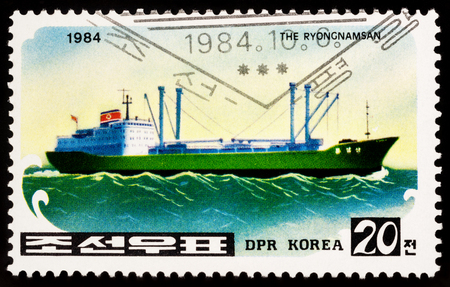 Foto per Moscow, Russia - March 11, 2018: A stamp printed in DPRK (North Korea) shows Korean freighter Ryongnamsan, series Korean ships, circa 1984 - Immagine Royalty Free