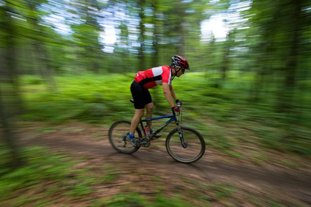 Mountain Biker during mtb competition with blurred background
