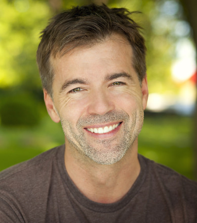Photo for Portrait Of A Mature Confident Man Smiling At The Camera - Royalty Free Image