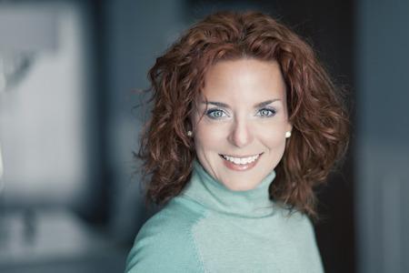Photo pour Closeup Of A Mature Woman Smiling At The Camera - image libre de droit