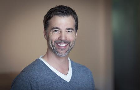 Foto de Closeup of a mature man smiling at home - Imagen libre de derechos