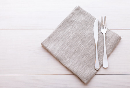 Photo for Empty plates, cutlery, tablecloth on white table for dinner. - Royalty Free Image