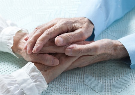 Old people couple holding hands closeup. Happy  family