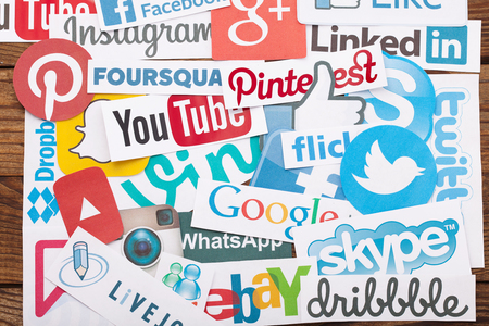 Photo for KIEV, UKRAINE - AUGUST 22, 2015:Collection of popular social media logos printed on paper:Facebook, Twitter, Google Plus, Instagram, Pinterest, Skype, YouTube, Linkedin and others on wooden background - Royalty Free Image