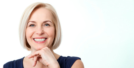 Photo for Attractive middle aged woman with beautiful smile on white background - Royalty Free Image