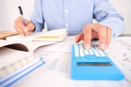 Foto de Financial investments concept with a calculator - Imagen libre de derechos