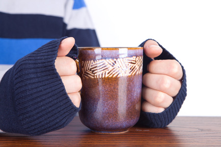 Photo for A person who warms hands with hot water in winter - Royalty Free Image