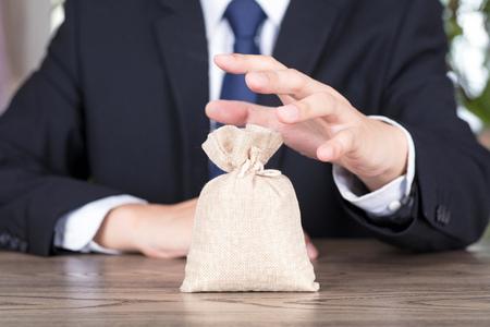 Foto de Financial concept with asset bag - Imagen libre de derechos