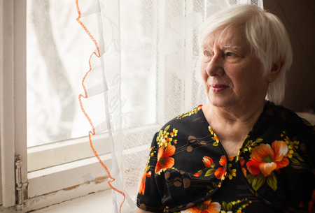 Photo for Senior lady with white hair in black dress looking at window - Royalty Free Image