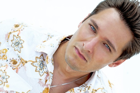 Photo for Portrait of handsome  man with blue eyes on the beach, white  yacht - Royalty Free Image
