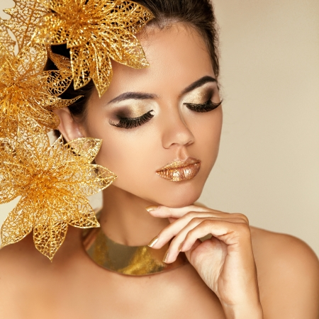 Eye Makeup. Beautiful Girl With Golden Flowers. Beauty Model Woman Face. Perfect Skin. Professional Make-up. Fashion Art Photo