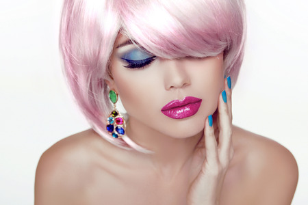Foto de Makeup. Sexy lips. Beauty Girl Portrait with Colorful Makeup, Coloring Hair, Nail polish and Earring. Isolated on white background. - Imagen libre de derechos