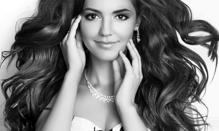 Beauty Fashion Girl Model Portrait. Long healthy Wavy hair. Professional makeup. Black and white photo