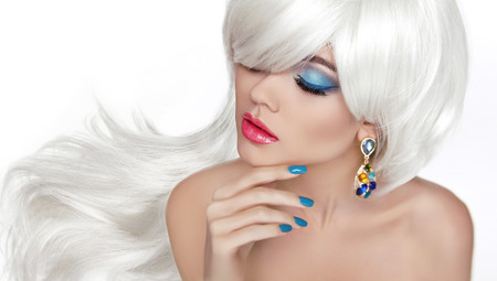 Photo pour White Long hair. Eye makeup. Beautiful blond with fashion jewelry, sensual red lips, manicured nails isolated on white background. - image libre de droit