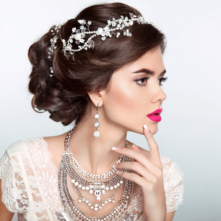 Photo for Beauty Fashion Model Girl with wedding elegant hairstyle. Beautiful bride woman with precious jewels, manicured nails. Makeup. Elegant style. - Royalty Free Image