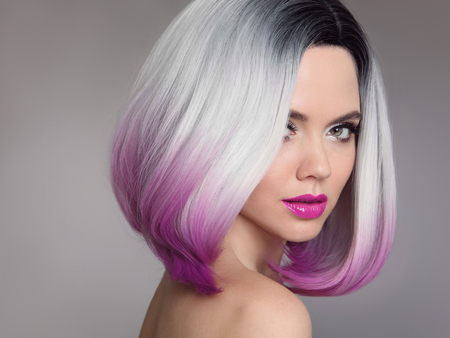 Photo for Colored Ombre hair extensions. Beauty Model Girl blonde with short bob purple hairstyle isolated on gray background. Closeup woman portrait. - Royalty Free Image