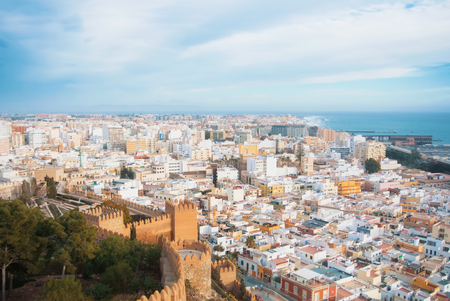 Foto per Aerial panoramic view of Almeria old town and sea coast from the castle (Alcazaba of Almeria) over the mountain, Andalusia, Spain. Fortress walls at the foreground. - Immagine Royalty Free